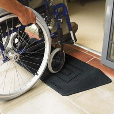 main in wheelchair going over a threshold wheelchair ramp